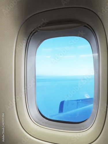 blue sky through airplane window