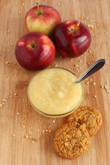 Apple sauce with oatmeal cookies and ted apples