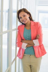 Portrait of a confident businesswoman with arms crossed at