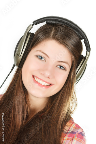 a portrait of happy smiling girl is in headsets