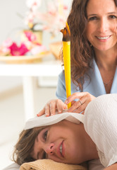 Terapist doing an ear candling