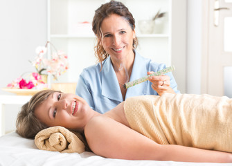 Alternative medicine therapist doing moxa treatment
