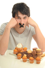 Man in love with sweets, candies,chocolate, sugar but restrain