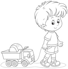 Little boy with a toy truck and ball