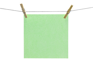 Flat green square sticky note hanged.