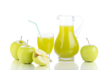 Fresh green apples, glass with juice and carafe