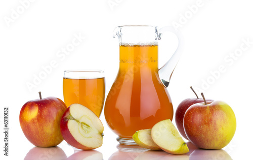 Fresh apples, glass with juice and carafe