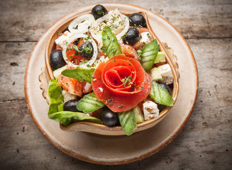 Fresh vegetable salad on wooden table