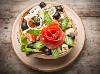 Fresh vegetable salad on wooden table