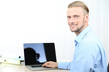 Man in office at workplace