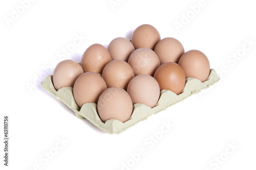 Twelve eggs in a dozen eggs cardboard