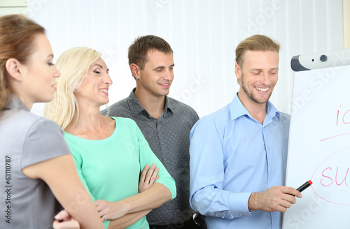 Business team working in office near whiteboard