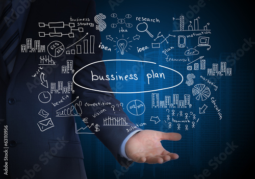 Man in suit holding business plan