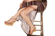 woman legs sit in slit skirt