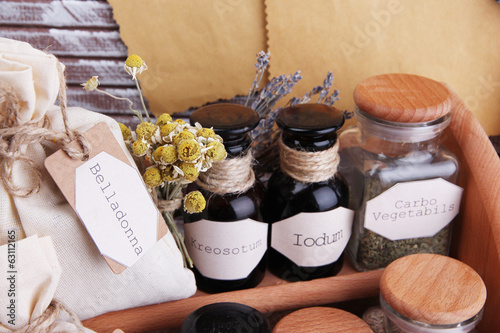 Historic old pharmacy bottles with label, notebook and roll,