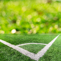 Corner of a soccer field and green bokeh