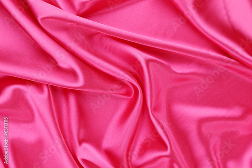Pink silk background. Texture.