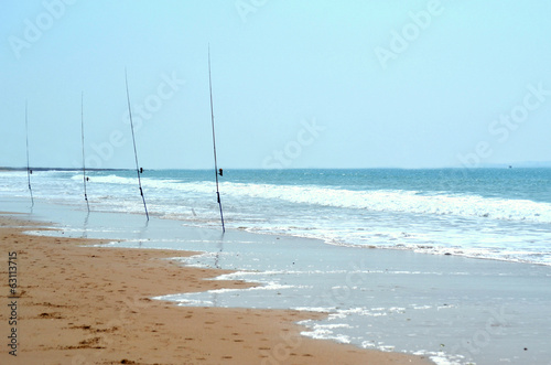 Fishing rods on the seashore in spring