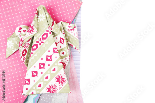 Origami xmas angel and color papers isolated on white
