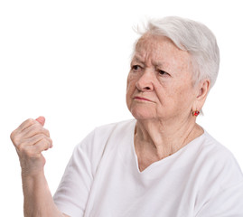 Angry old woman making fist