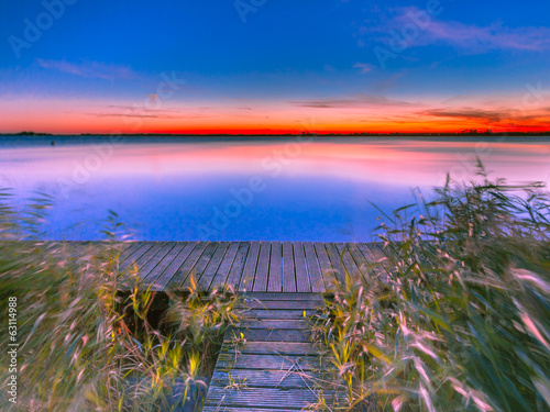 Long Exposure Image of Blue and Orange Sunset over Jetty on the