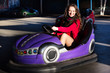 Teenage girl in an electric bumper car