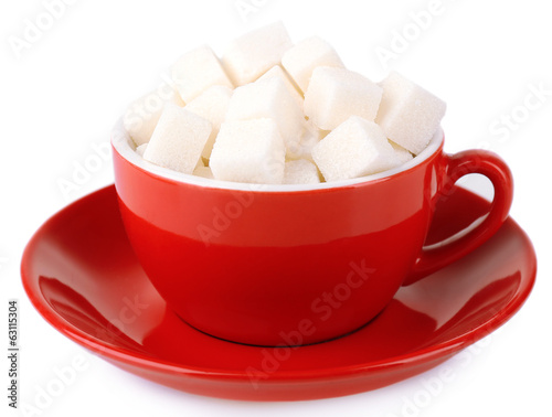 Sugar in cup isolated on white