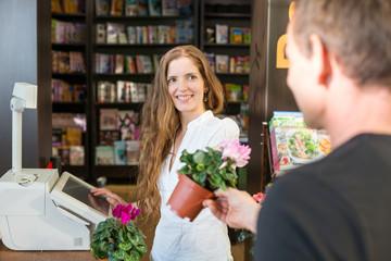 Cashier in flower shop or Garden Center serving customer