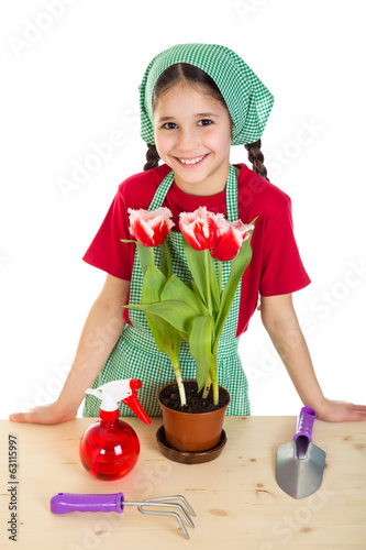 Girl care flowers on the desk