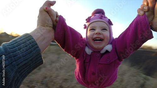 Man Rotates His Little Daughter Outdoor, First Person View From