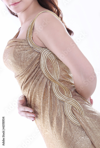 female torso in gold dress