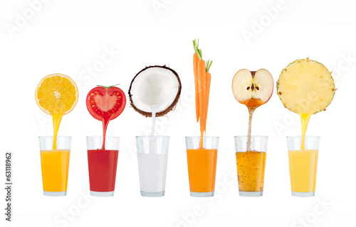 fresh juice pours from fruits and vegetables in a glass