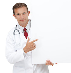 Happy doctor showing blank board / sign.
