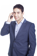Portrait of businessman talking on mobile phone, isolated on whi