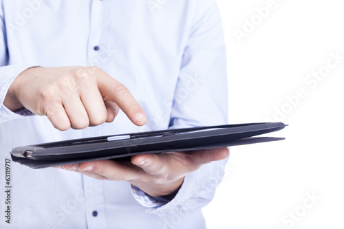 Business man working with a digital tablet, close-up