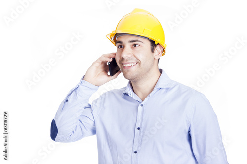 Handsome engineer talking on the phone, isolated on white