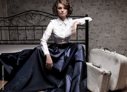 Beautiful woman in long skirt and white blouse