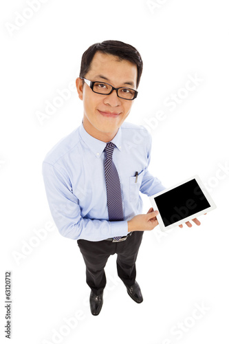Portrait of a businessman with a tablet
