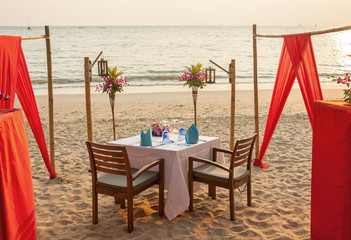 Romantic evening table for two persons on the beach.