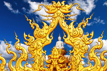 Buddha statue against a blue sky with clouds. Chiang Rai.
