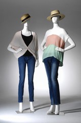 Two Fashion clothes in hat with bag on a mannequin