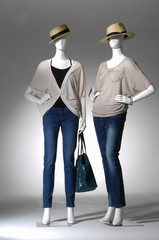 female clothing in jeans with bag ,hat on two mannequin