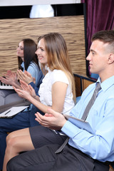 Group of people clapping hands during meeting conference