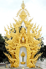 Golden sculpture the place for buddha statue of Wat Rong Khun, t