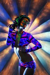 Showy heavily made girl dancing in nightclub