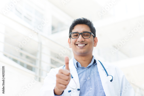 Asian Indian male medical doctor thumb up