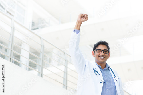 Asian Indian male medical doctor celebrating success