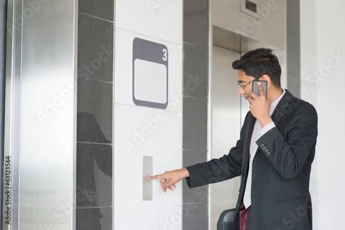 Indian businessman entering elevator