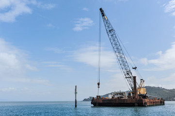Floating barge with a large crane