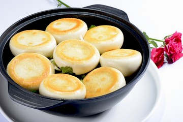Chinese Food: Toasted Dumplings in a black pot